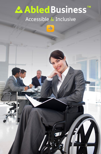 AbledBusiness link button shows a businesswoman in a grey suit sitting in a wheelchair in the foreground with a report in her lap with her colleagues working at a desk in the background