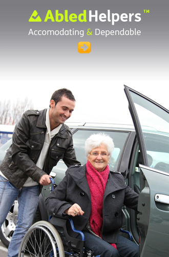 AbledHelpers link button shows a young man helping an elderly woman to transfer from her wheelchair to a car