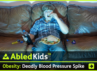 AbledKids headline link banner shows an overweight boy eating junk food while sitting on the couch watching TV and reads: Obesity-Deadly blood pressure spike. Click to go to the story.