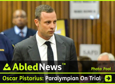 AbledNews Post link Banner shows a photograph of Oscar Pistorius entering a courtroom in Pretoria, South Africa. He has a youthful face with closed-cropped hair and is wearing a gray suit with a white shirt and black tie. The headline reads: Oscar Pistorius: Paralympic Gold Medalist is On Trial For Murder In South Africa. Click here to go to the post.