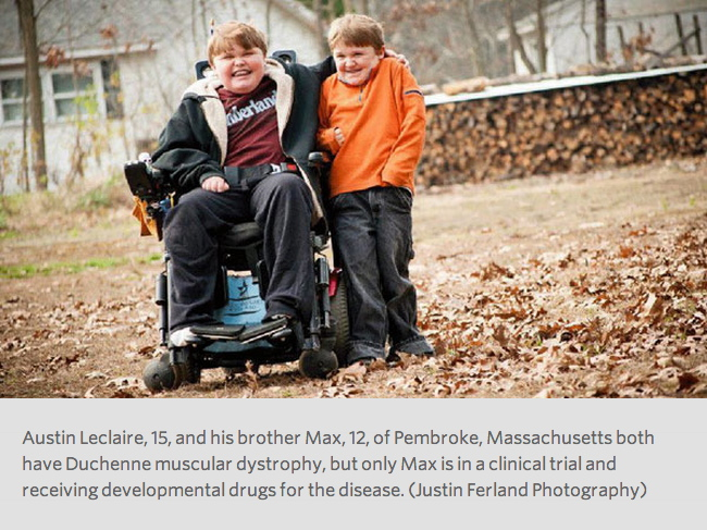 Photo by Justin Ferland Photography shows 15 year old Austin Leclaire sitting in an electric wheelchair with his left arm around the shoulder of his 12 year-old brother Max in the backyard of their home in Pembroke, Massachussetts. Both show the physical effects of Duchenne muscular dystrophy but they are less pronounced in Max who is receiving experimental drugs for the disease. Both boys are smiling at the camera and you can see fallen autumn leaves and a woodpile in the background.
