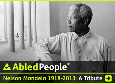 AbledPeople link banner shows a black and white photo of former South African President Nelson Mandel looking out between the bars on the window of his former prison cell. The headline reads: Nelson Mandela: 1918-2013: A Tribute. Click here to go to the post.