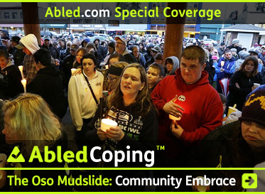 AbledCoping link box shows a large crowd of people in Arlington, Washington gathered for an outdoor candlelight vigil for the victims and families of the Oso mudslide. Click here to go to the post for more special coverage on how the communities involved are coping.