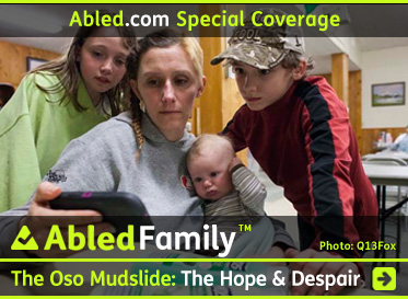 AbledFamily-Special Coverage Link Box shows a photo of Loanna Langton holding her baby with her children standing behind her as they look for news of the mudslide on her smartphone while staying at a temporary shelter in nearby Darrington after their home was flooded after the Oso mudslide. The headline reads Abled Family: The Oso Mudslide: The Hope And Despair. Clicj here to go to the post.
