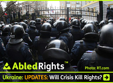 AbledRights Post Link Banner shows riot police standing guard in front of the regional administration in Donetsk, Ukraine before nearly a hundred pro-Russian protestors seized two floors of the building. Click here to go to the Post.