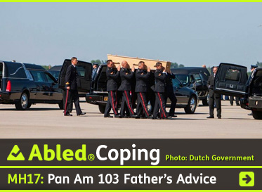 AbledCoping-link box shows members of the Dutch Armed Forces carrying coffins from two transport planes to waiting hearses at Eindhoven Air Base in the netherlands. The headline reads: MH17: Pan Am 103 father's Advice. Click here to go to the post.