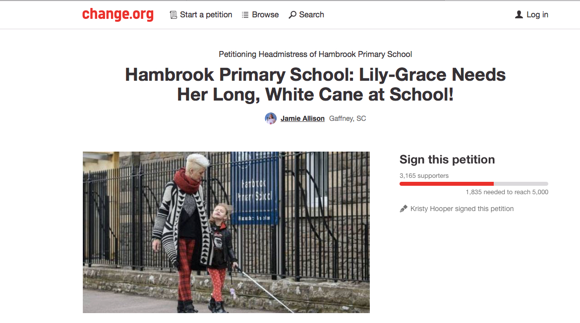 A screen grab of petition at Change.org reads: Petitioning Headmistress of Hambrook Primary School. Hambrook Primary School: Lily-Grace Needs Her Long, White Cane at School! The photo shows 7-year-old Lily Grace, walking outside the gates of the school, cane in hand, with her mother Kristy by her side. Click the banner to sign the petition which had 3,165 signatures as of this writing. It needs 1,835 more to reach 5,000.