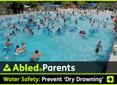 AbledParents: Water Safety: Prevent 'dry drowning'. Image: Photo shows a large and crowded outdoor public swimming pool.