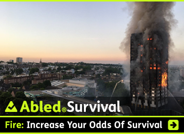 AbledSurvival: Fire: Increase your odds of survival. Image; Photo shows fire and smoke rising from the Grenfell Towers apartment building in London at dawn.