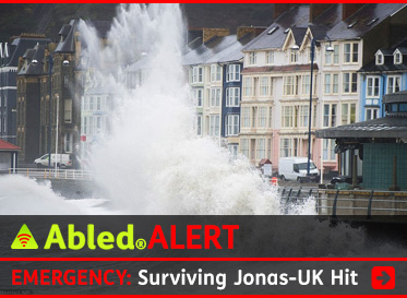 AbledALERT headline link box shows waves pounding the coast of Wales as the text reads: Emergency: Surviving Jonas-UK Hit. Click to go to the survival guide coverage.