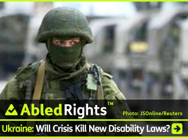 AbledRights link banner shows a Russian Soldier standing guard in a green helmet with a green winter mask covering his face except for his eyes as a convoy of trucks passes by him out of focus in the background. The headline reads: AbledRights - Ukraine: Will Crisis Kill New Disability Laws?. Click here to go to the Post.