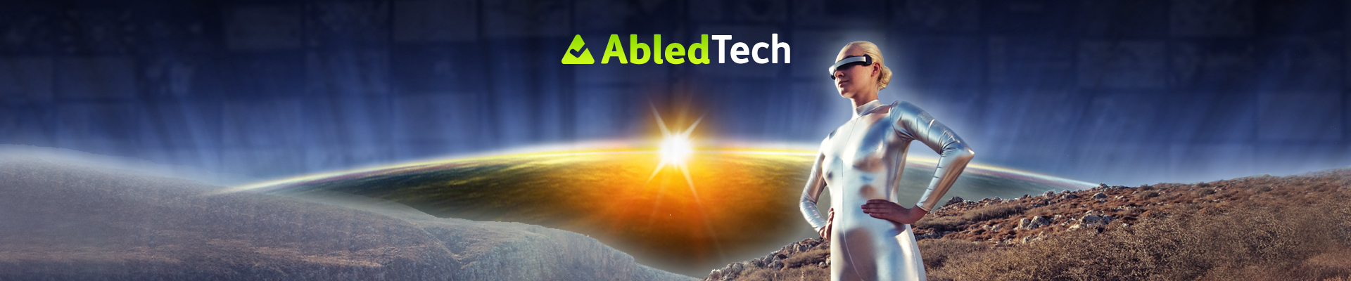 AbledTech network link shows a woman in a silver bodysuit with virtual reality goggles standing on a hillside