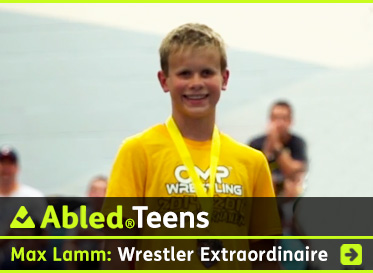 AbledTeens link banner headline reads: Max Lamm - Wrestler extraordinaire. A screen grab from a video profile of Max shows the 13 year-old Wrestler wearing a yellow T-shirt and smiling towards the camera after he's just been awarded a wrestling medal. Max has sanely blonde hair cut neatly. Max was diagnosed with retinoblastoma as an infant and progressively lost his vision. Click here to go to the story.
