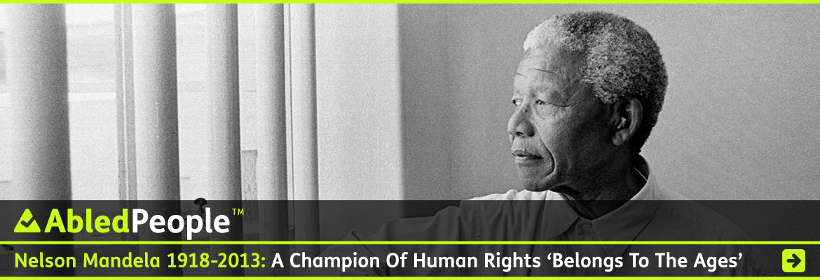 AbledPeople link banner shows a black and white photo of former South African President Nelson Mandel looking out between the bars on the window of his former prison cell. The headline reads: Nelson Mandela: 1918-2013: A Champion Of Human Rights Belongs To The Ages. Click here to go to the story.