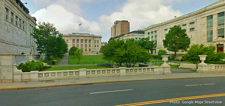 Photo from Google maps streetview shows a tree-filled grassy central park area flanked by the buildings of Harvard Medical School in Boston.