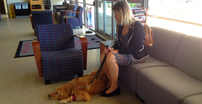 Laura Meddens sits with Waggie in the waiting area of the Small Animal Clinic at Texas A&M University's College of Veterinary Medicine and Biomedical Sciences in College Station, Texas.