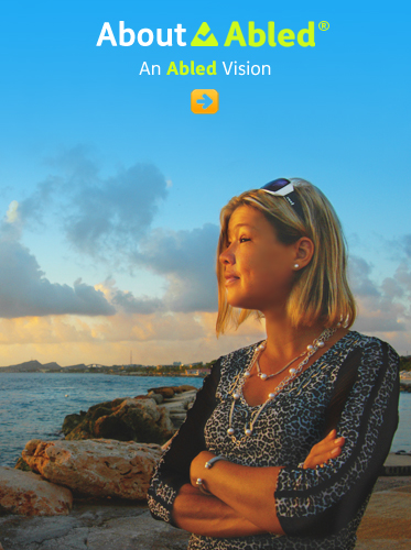 About Abled - An Abled Vision shows Abled.com Co-Founder Laura Meddens photographed at the seaside in Curaçao at dusk