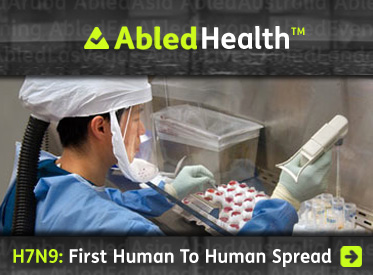 AbledHealth story link headline reads: H7N9: First Human to Human Spread. A photo provided by the Centers for Disease Control shows a lab worker sorting samples of flu virus into vial trays while dressed in protective lab gear