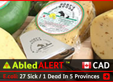 AbledALERT-Outbreak-Canada link box shows a screengrab of the Gort's Gouda Cheese Farm website which shows a photo of a variety of cheeses with the headline: E.coli: 27 Sick / 1 Dead In 5 Provinces. Click here to go to the story.