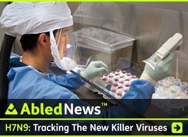 AbledNews story link box headline reads: H7N9: Tracking The New Killer Viruses. A photo provided by the Centers for Disease Control shows a lab worker sorting samples of flu virus into vial trays while dressed in protective lab gear. Click to go to the story.