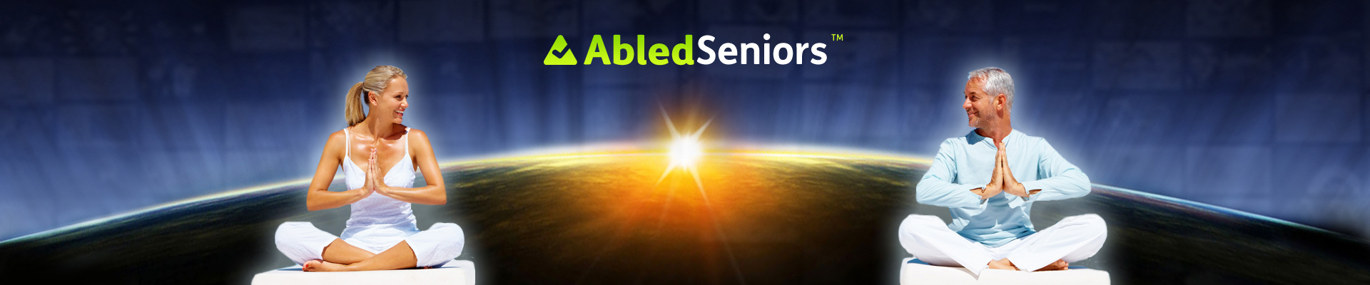 AbledSeniors banner shows an older man and woman sitting in the lotus position with their palms together and looking at each other while they sit on cushions in the foreground over the background of the Earth at sunrise as seen from space with the Abled Seniors logo centered above.