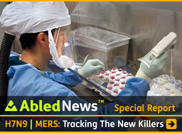 Special Report - AbledNews- story link box headline reads: H7N9: Tracking The New Killer Viruses. A photo provided by the Centers for Disease Control shows a lab worker sorting samples of flu virus into vial trays while dressed in protective lab gear. Click to go to the story.