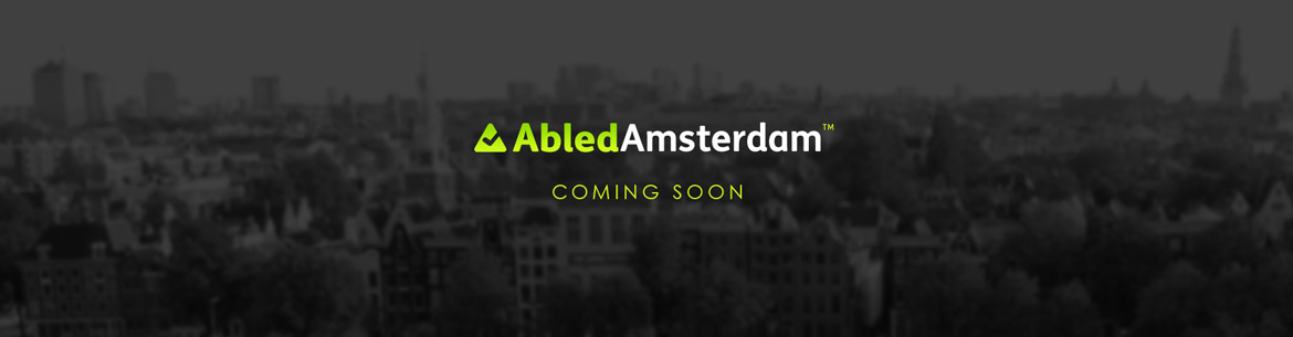 AbledAmsterdam preview banner shows the same cityscape as the main banner in subdued black and white with the AbledAmsterdam logo and the words Coming Soon.