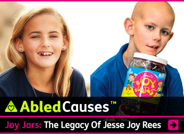 AbledCauses story link deadline reads: Joy Jars: The Legacy of Jesse Joy Rees over a photo of Jesse, who lost her battle with cancer, and a photo of a young boy who has lost all his hair to chemotherapy and who is holding one of the Joy Jars full of small toys and treats. Click here to go to the story.