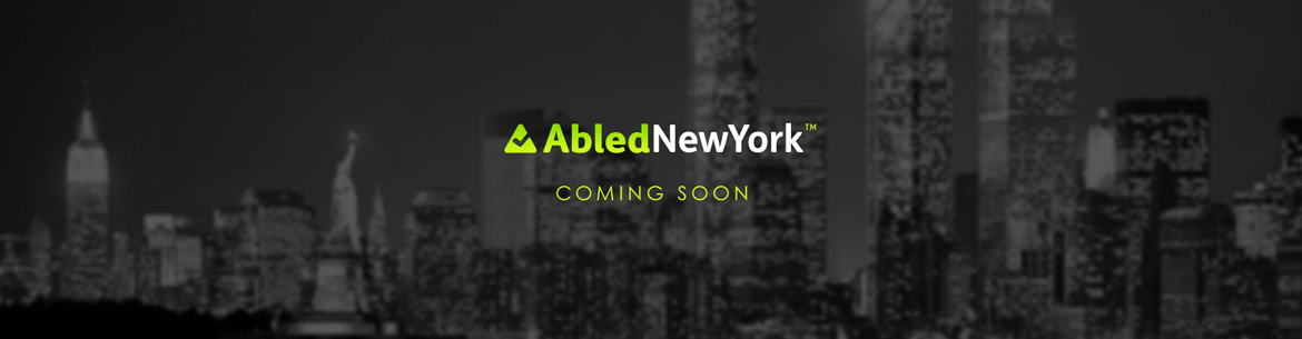 AbledNewYork banner features the same cityscape as the main banner but subdued in black and white with the AbledNewYork logo and the words Coming Soon.