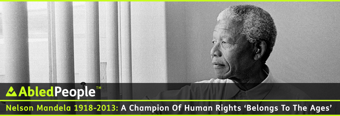 AbledPeople post banner shows a black and white photo of former South African President Nelson Mandel looking out between the bars on the window of his former prison cell. The headline reads: Nelson Mandela: 1918-2013: A Champion Of Human Rights Belongs To The Ages.