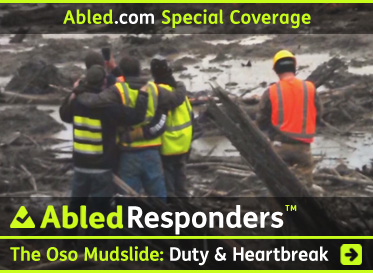 AbledResponders Special Coverage link box shows a photo of search and rescue workers in a group hug after the sister of one of the workers was found in the mud and debris after the Oso mudslide in Washington State. The Headline reads: AbledResponders: The Oso Mudslide: Duty and Heartbreak. Click here to go to the post.