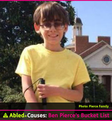 Abled Causes photo shows nine-year-old Ben Pierce standing outside on a sunny day with a church and a tall bushy tree behind him. Ben has brown hair and his wearing a yellow t-shirt and tinted glasses. He is holding the grip of a walking cane in his left hand and is smiling at the camera. Click here to go to the give forward campaign that is raising money for his bucket list.