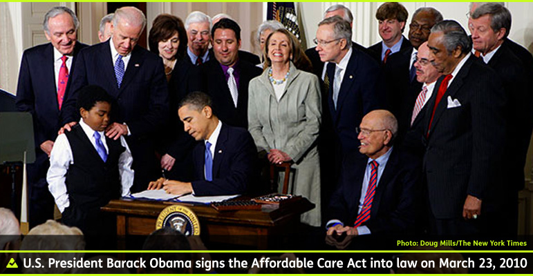 AbledHealth Photo shows U.S. President in the Oval Office at the White House surrounded by invited politicians and other people as he signs into law the Affordable Care Act that has since become known as Obamacare in March of 2010.