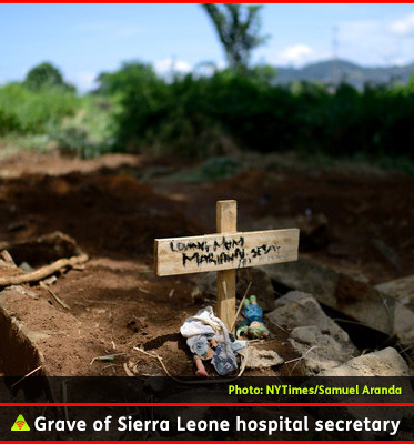 AbledALERT photo shows a photo from the New York Times of the grave of Marion Seisay, a secretary at Wilberforce Hospital in Sierra Leone. Area residents say animals dig near the graves, creating dangers for the living because the Ebola virus is still contagious in the corpse of a victim. Click here to read the story at the New York Times.