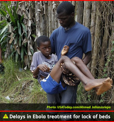 AbledALERT photo shows a man carrying his adolescent brother who is suspected of having Ebola after being turned away from a treatment center in Monrovia, Liberia because of a lack of beds.