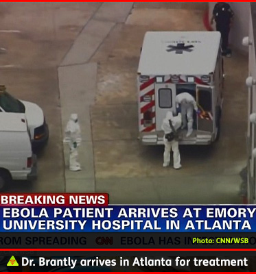 AbledALERT photo shows a screen grab from video being shot from a helicopter as a specially fitted ambulance arrives at Emory University Hospital in Atlanta as Dr. Kent Brantly arrives for treatment of his Ebola infection. The headline on the screen reads Breaking News: Ebola patient arrives at Emory University hospital in Atlanta. Dr. brainily is wearing white protective medical gear from head to toe and steps out of the ambulance and walks on his own.
