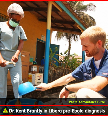 AbledALERT Photo shows American Dr. Kent Brantly using bleach to sterilize some equipment in a plastic tub outside an Ebola clinic in Liberia. He is not wearing any protective equipment. He is tall and thin and has short blind hair with a reddish-blinds beard. He is a missionary doctor with the Samaritin's Purse aid organization. He was soon to be diagnosed with the Ebola virus.