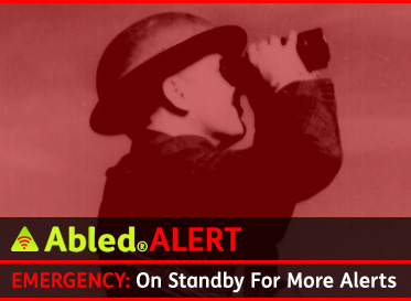 AbledALERT-EMERGENCY -Placeholder Banner shows a black and white photo of a rooftop lookout in London during the Second World War wearing a helmet and looking skyward through binoculars. The text reads: On Standby for more Alerts.