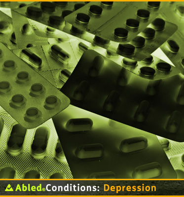 AbledConditions: Depression: Photo shows vacuum-packed foil-backed packages of differently shaped pills and tablets stacked haphazardly on top of each other.