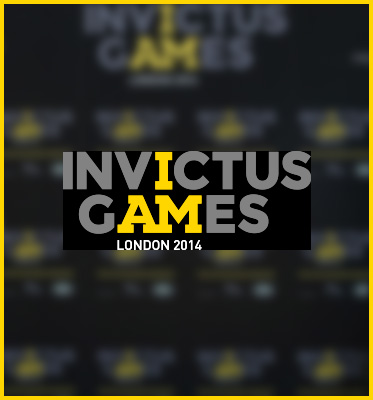 AbledWarriors -Invictus Games Logo is set against a blurred black backdrop that contains a repeating pattern of the logo for Invictus Games. The word Invictus is in a medium gray with the letter I in yellow and sits on top of the word games which is also in gray except for the letters a and m. Together the yellow letters form the phrase I AM. Underneath in smaller text are the words London 2014.