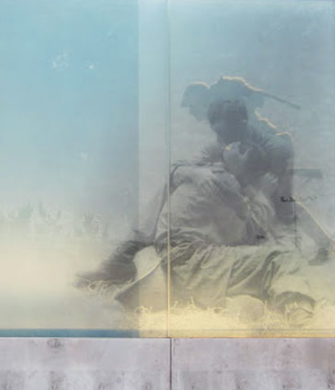 AbledWarriors Photo shows a photograph of two of the panels from the American Veterans Disabled For Life Memorial in Washington, D.C. . A photo of a soldier comforting a wounded comrade is etched into the glass while a braze sculpture outline of a solider in full battle gear walking in a crouched position is seen in the background.