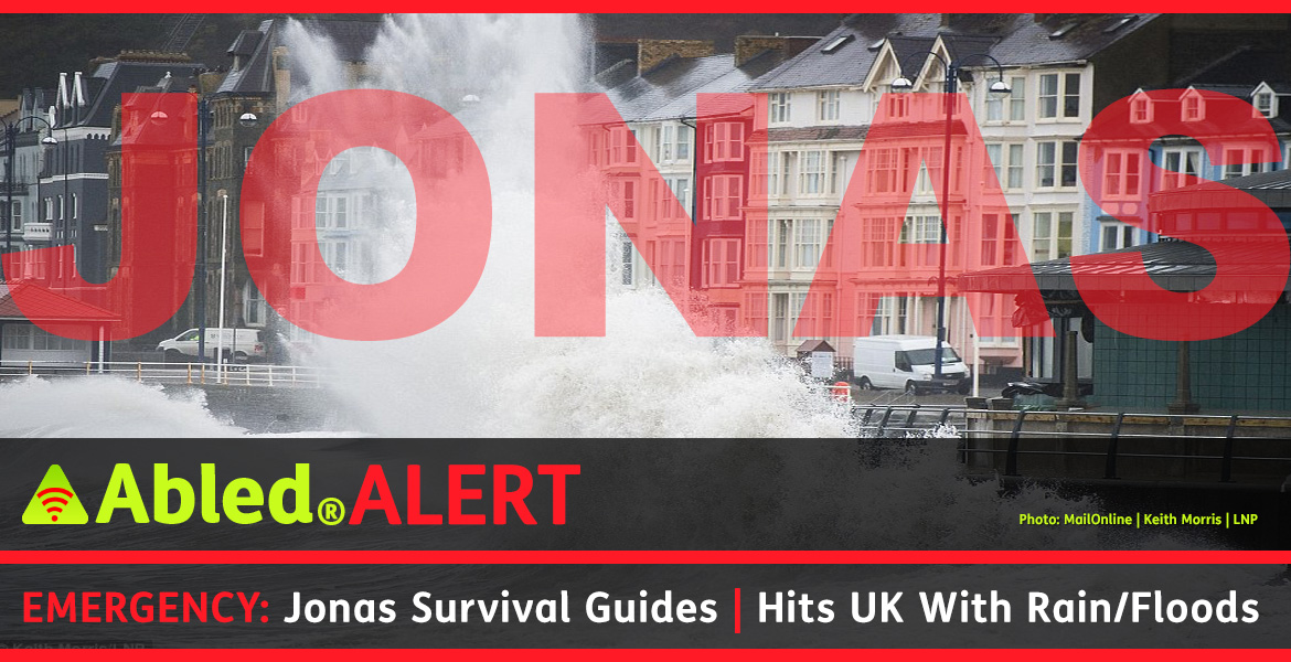 AbledAlert Post headline banner shows huge waves splashing against the coast of Wales. The text reads: Emergency: Jonas Survival Guides | Hits UK with Rain/Floods.