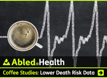 AbledHealth link box shows a cup of coffee as seen from above sitting on a chalkboard on which an electrocardiogram waveform has been drawn in chalk. The headline reads: Coffee Studies: Meta-analysis links lower risk of a sudden death. Click the box to go to the story.