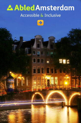Abled.Amsterdam link box shows historic houses beside a canal bridge all lit up at night.