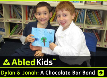 AbledKids link box shows a photo of best friends Dylan and Jonah at a library reading of Dylan's book Chocolate Bar which he designed and wrote himself to raise money for research into his friend Jonah's rare disease. It's gone viral and raised over 750 thousand dollars. Click here to go to the Post.