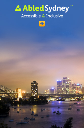 AbledSydney link button shows part of Sydney harbor and bridge lit up at dusk