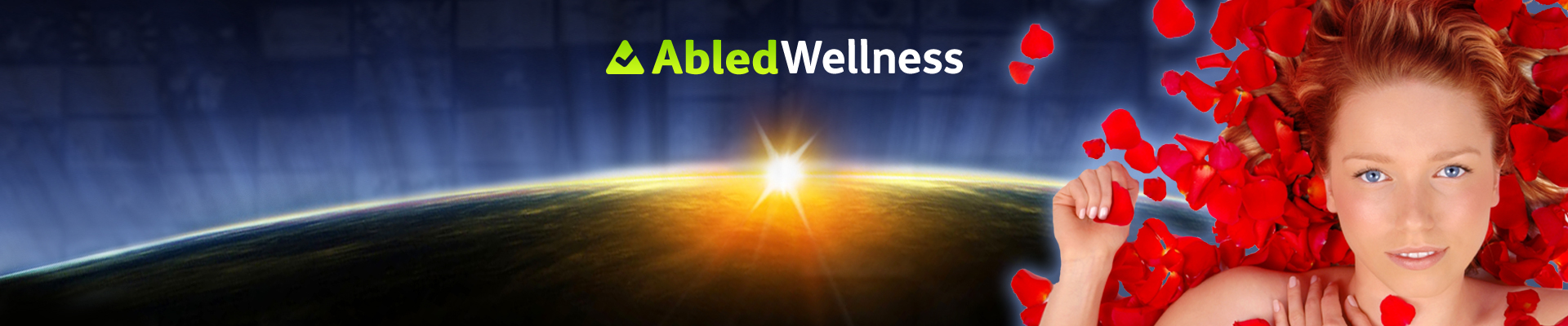 AbledWellness banner shows a young woman laying on a bed of roses