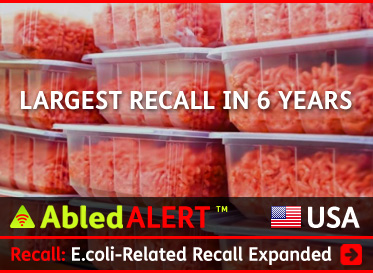 AbledAlert headline link box shows packages of ground beef stacked on shelving with the headline Recall: E.coli-related recall Expanded. CLick here to go to the post.