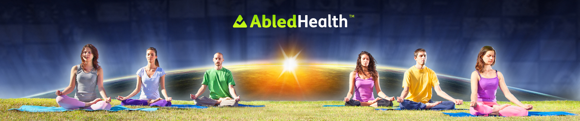 AbledHealth banner shows 4 people meditating in the lotus position on the grass in front of a digital backdrop of a sunrise over the edge of the earth.