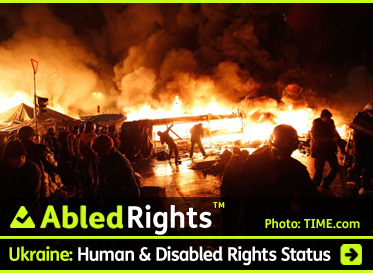 AbledRights link banner shows protestors silhouetted against flames burning at night from Molotov cocktails in Kiev's Independence Square. The headline reads: Ukraine: Human and Disabled Rights Status.Click here to go to the post.